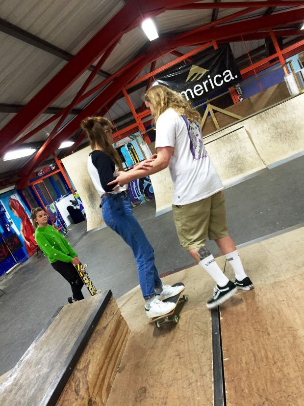 Skate Worker Joe helps Molly with her first time down the flat bank!